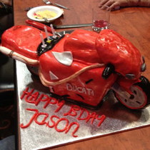 A red motorbike cake by Sooo Delicious brightened up Jason's birthday.