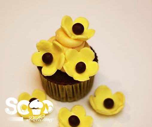 This yellow floral cupcake is both tasty and attractive.